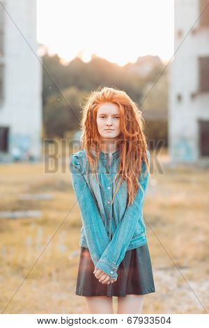 Young Stylish Girl With Dreadlocks Outdoors