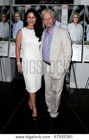EAST HAMPTON, NEW YORK-JULY 6: Actors Michael Douglas (R) and Catherine Zeta-Jones attend the premiere of