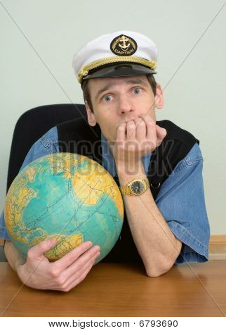 Seaman Misses On Distant Travel Sitting At Table With Globe