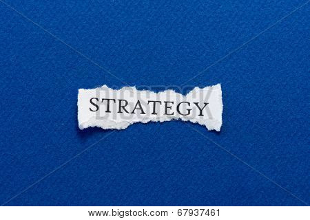 A scrap of paper with the word strategy
