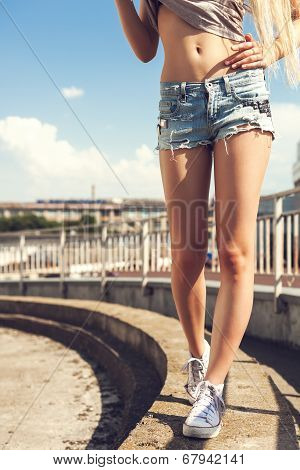 Woman Legs In White Gumshoes