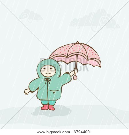 Cute little girl wearing green raincoat and enjoying monsoon season.