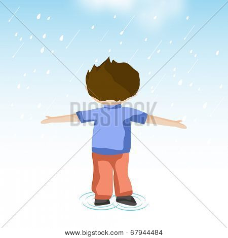 Little boy extending his arms to enjoy the rain drops, Monsoon Season background.