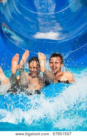People Water Slide At Aqua Park