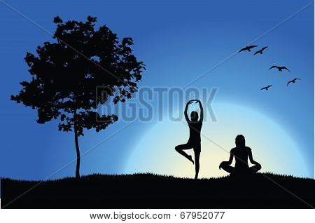Two Yoga Girls On Hill Near Tree, Blue Background