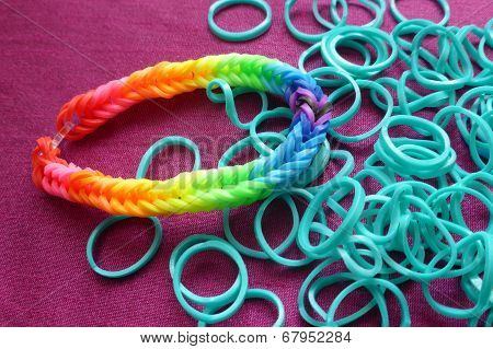 Rainbow colored loom band bracelet