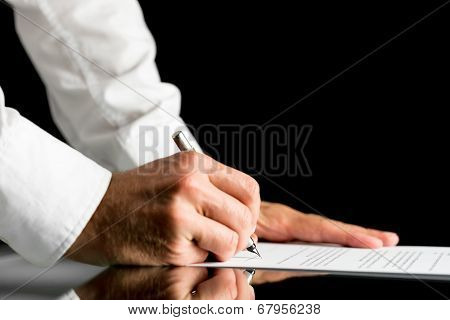 Man Signing With A Pen An Official Document