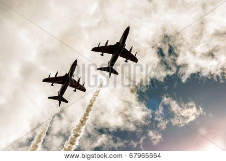 Two Armed Flying Fighter Jets In The Sky
