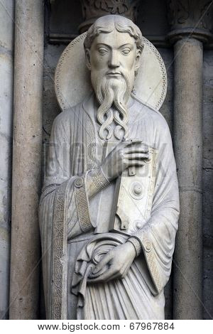 PARIS, FRANCE - NOV 05, 2012: Saint Paul, architectural detail of Notre Dame cathedral. Portal of St. Anne was the first of the three west portals to be installed (c.1200).