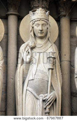 PARIS, FRANCE - NOV 05, 2012: Queen of Sheba, architectural detail of Notre Dame cathedral. Portal of St. Anne was the first of the three west portals to be installed (c.1200).