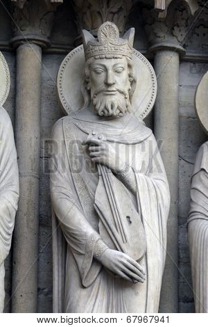 PARIS, FRANCE - NOV 05, 2012: King David, architectural detail of Notre Dame cathedral. Portal of St. Anne was the first of the three west portals to be installed (c.1200).