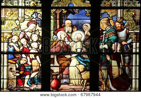 PARIS, FRANCE - NOV 11, 2012: Sainte-Genevieve giving sight to his mother in the presence of Saint-Marcel.The Church of St Severin is Catholic church in the Latin Quarter.