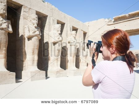 Girl Is Photographing An Ancient Statues In Karnak