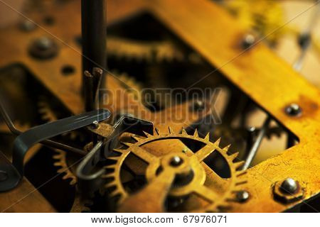 Clockwork. Old brass gears of clock mechanism