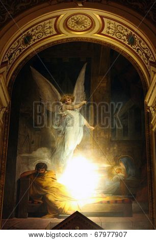 PARIS, FRANCE - NOV 09, 2012: Angel appears to Joseph and warns Joseph to take Jesus and his mother into Egypt, Holy Trinity church is a Catholic church located in the 9th arrondissement.