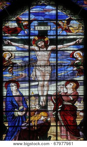 PARIS, FRANCE - NOV 09, 2012: Crucifixion, Jesus on the cross, stained glass. Church of Saint-Jean-de-Montmartre situated at the foot of Montmartre. Built from 1894 through 1904, Nov 09, 2012 in Paris