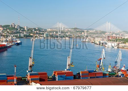 Front view of  russian port Vladivostok against the downtown and new bridge over Golden Horn bay