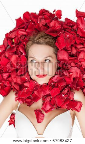 rose petals around a beautiful woman's face