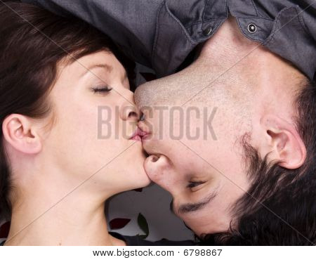 Man kissing woman on the cheek.
