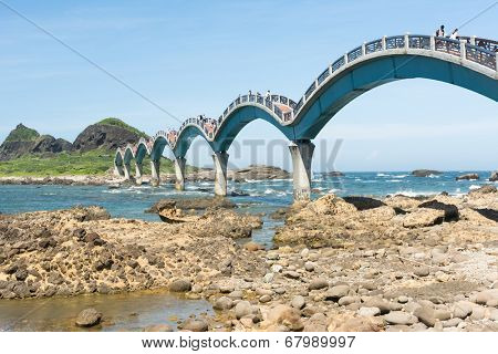 TAITUNG, TAIWAN - JUN 22th : Famous bridge at Sanxiantai, with many tourists on June 22th, 2014 in Chenggong Township, Taitung County, Taiwan, Asia.