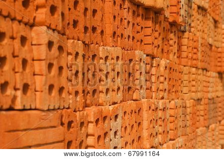 Pile Of Orange Bricks For Pattern And Construction