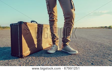Traveler Stands Near The Suitcase