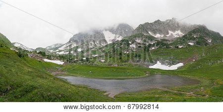 Lake Psenodah and mountains Pshekha-Su in cloudy weather