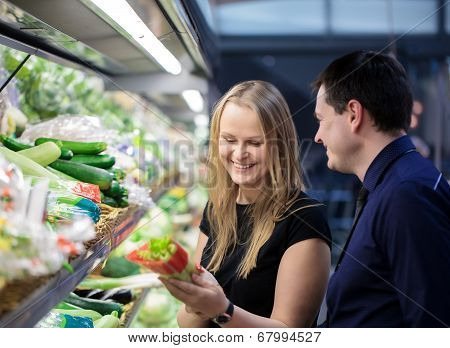 Man and woman shopping for vegetables