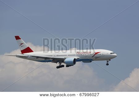 Austrian Airlines Boeing 777 in New York sky before landing at JFK Airport