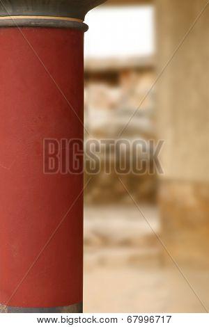 Knossos palace archaeological site Crete Greece red pillar closeup