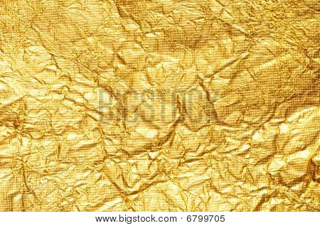 Crumpled Gold Foil Textured Background