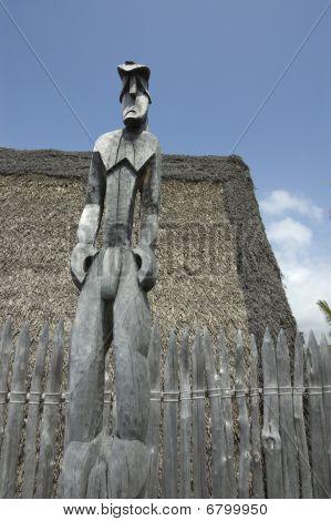 Tiki Idol Carved On Wood.