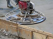 picture of trowel  - Helicopter concrete finishing. Construction worker finishing concrete with power trowel machine.