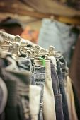 picture of thrift store  - clothes on a rack on a flea market - JPG