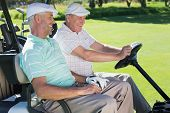 stock photo of buggy  - Golfing friends laughing together in their golf buggy on a sunny day at the golf course - JPG