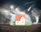 pic of meteoric rain  - Concept of home protection insurance with crystal sphere - JPG
