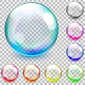 pic of orbs  - Set of multicolored transparent glass spheres on a plaid background - JPG