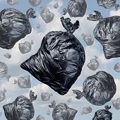 stock photo of waste management  - Garbage concept as black trash bags with an unpleasant smell falling from the sky as a background of environmental damage issues and waste management problems - JPG