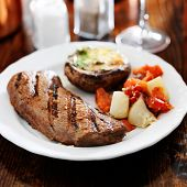 pic of braai  - grilled steak with potatoes and stuffed mushroom - JPG