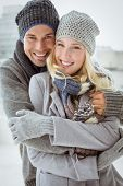 pic of chillies  - Cute couple in warm clothing smiling at camera on a chilly day - JPG