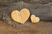 stock photo of elm  - Two Love Valentines wooden hearts from recycled old palette on old grey Elm background copy space - JPG
