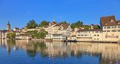 stock photo of rudolf  - Zurich view across the Limmat river from the Rudolf Brun bridge towards the Lindenhof park in summer early morning - JPG