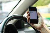 stock photo of unsafe  - Texting and driving is dangerous and no unsafe.