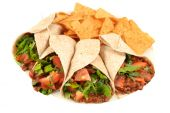 stock photo of mexican food  - Delicious and colorful mexican fajitas or wraps and crunchy nacho chips isolated on a white background - JPG