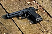 image of 9mm  - A black 9mm gun on a ground - JPG