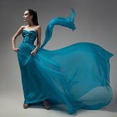 stock photo of flutter  - Fashion woman in fluttering blue dress - JPG