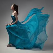 image of flutter  - Fashion woman in fluttering blue dress - JPG
