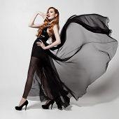 foto of flutter  - Fashion woman in fluttering black dress - JPG