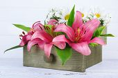 picture of wooden crate  - Beautiful flowers in crate on wooden background - JPG