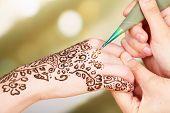 picture of mehndi  - Process of applying Mehndi on female hand - JPG